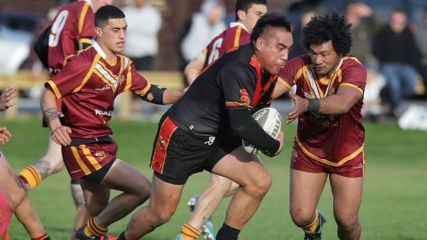 Waikato forward Namu Puru with the ball takes on the Rams players, with Lima Leiataua, on right looking to make a tackle ...
