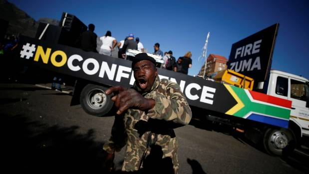 Anti-Zuma protesters march ahead of the vote of no-confidence against President Jacob Zuma in Cape Town, South Africa.
