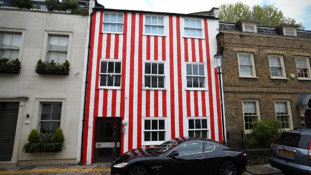 The owner of this house in the posh London suburb of Kensington painted candy stripes on her house after her neighbours ...