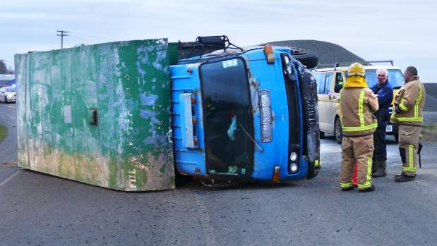 Steve Lock's horse truck lies overturned at the corner of Otautau-Wreys Bush Rd and SH96 after a crash with a car on ...