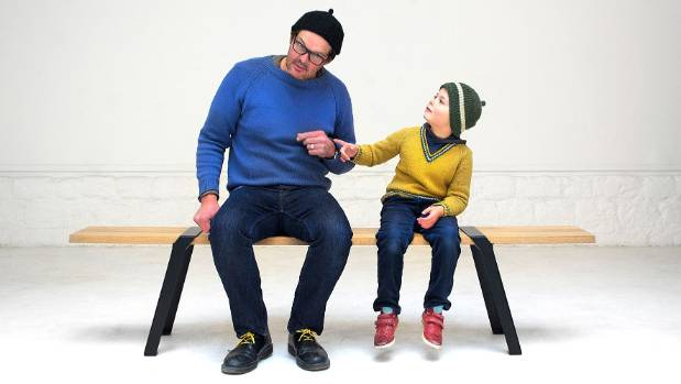 Expat designer Roderick Fry and his son  Arlo sit on his self-designed Pi System bench.
