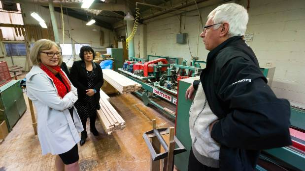 Minister of Small Business Jacquie Dean, left, and National Party candidate Adrienne Pierce are shown around the shop ...