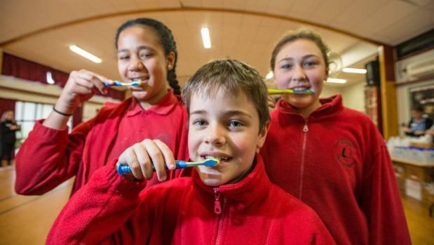 Pupils at Redwoodtown School, from left, Dita Tahavalu, 11, William Ruffell, 7, and Savannah Tasi-Hill, 11, got free ...