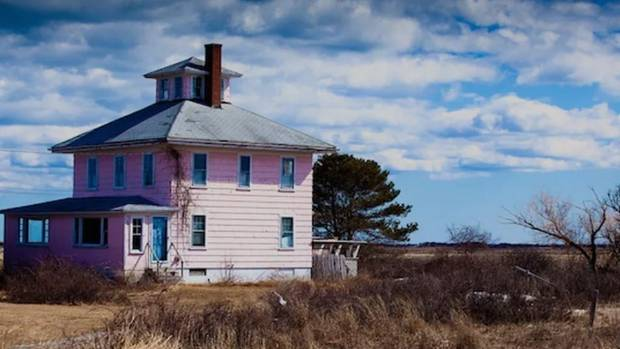 The pink 'spite house' was built by a man for his ex-wife as part of a separation agreement that determined he should ...