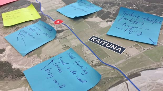 The public leave post-it notes to describe which sections of State Highway 6 need attention.