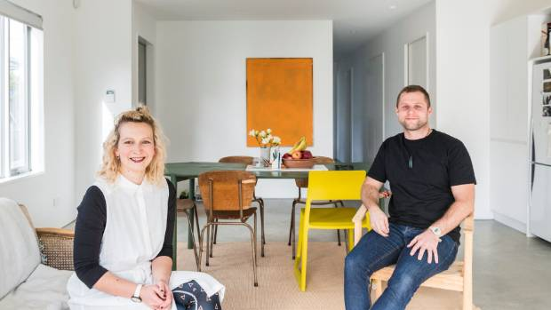 Chloe Coles and Jono Coates designed their house, which has an open plan kitchen, living and dining area, with ...