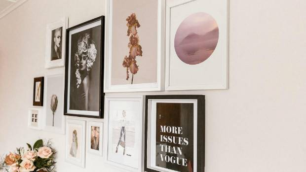 Muggeride has created a chic gallery wall in her makeup room.