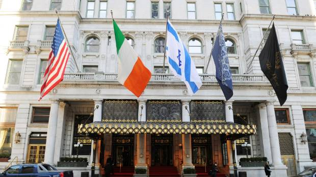 Flags fly outside The Plaza Hotel.
