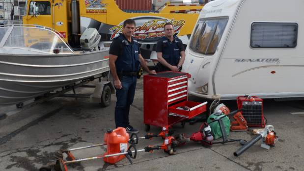 Senior Constable Bradley Clark, left, and Detective Constable James Forgie of Hawke's Bay police with a number of items ...
