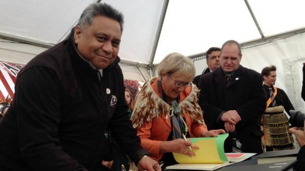 Rangitane negotiators Jason Kerehi, Mavis Mullins and Tipene Chrisp sign the Deed of Settlement with the Crown in ...