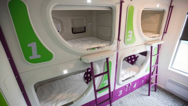 Airport investment in the Jucy Snooze pod hotel has angered some central city backpacker hostels starved for custom.