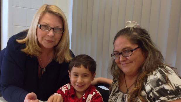 Lynn Cumming with  Melissa Adams and her son Arapeta at Waiheke Adult Learning.