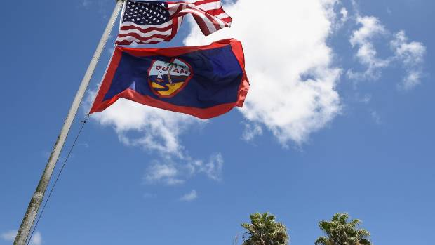 The flag of the USA and Guam fly together.