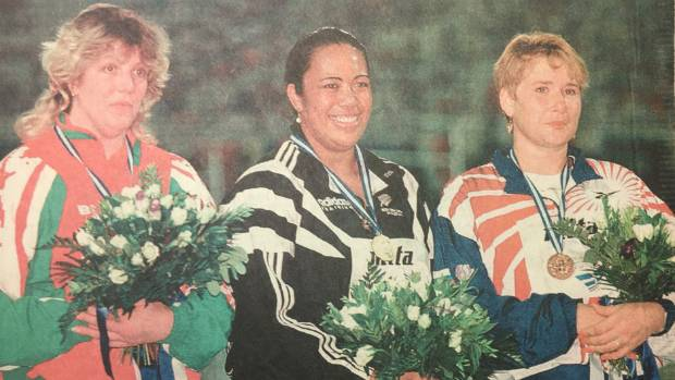 Ellina Zvereva of Belarus, left, and Natalya Sadova of Russia flank Faumuina at the medal ceremony.