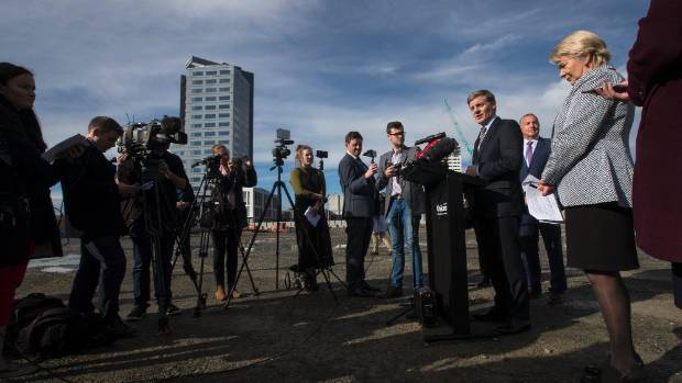 Prime Minister Bill English speaks at a press conference in the empty lot where the Christchurch convention centre will ...