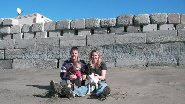 Mark Lawrence and family in 2009, when he was told his recently completed seawall had to come down.