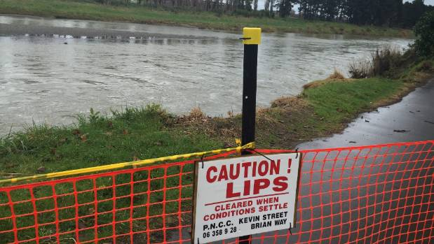 Someone has interfered with the sign fencing off a part of the Manawatu Riverside shared pathway at the back of Victoria ...