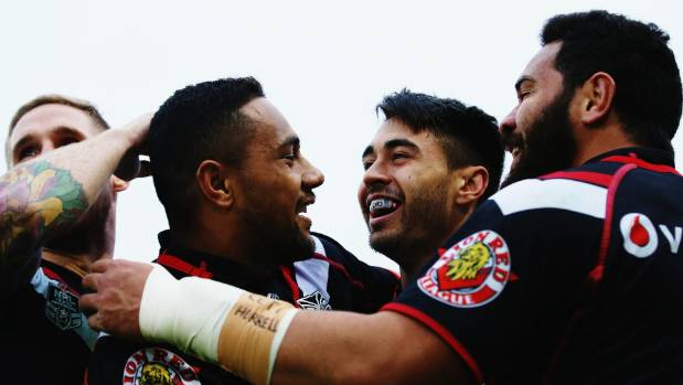 All Black Ngani Laumape is congratulated by his former Warriors team-mates, left to right, Sam Tomkins, Shaun Johnson ...