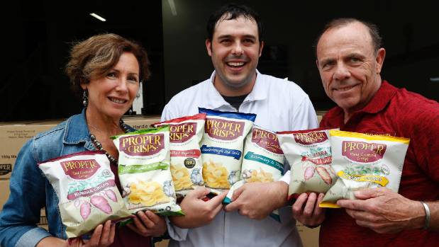 Mina Wilkie-Smith, Eddie Smith, centre and Ned Smith owners Proper Crisps, at their Nelson factory.