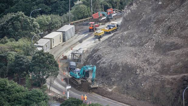 Rockfall protection containers are installed as work on the Ngaio Gorge slip in Wellington continues on Friday morning.