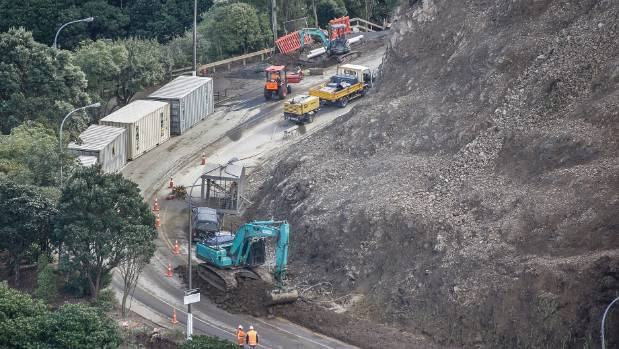 Contractors work to clear the previous slip Ngaio Gorge Rd. A new slip has closed the road again.