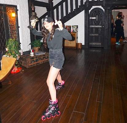 CHARLI XCX: So here's Charli XCX, rollerblading in her house while holding a fake Oscar and a light-up fidget spinner. ...