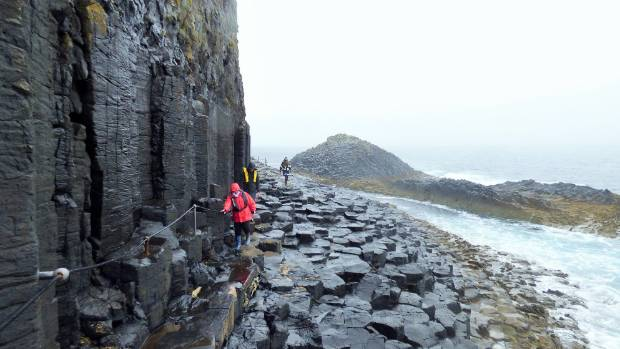 My wife and son navigating the cliff of columnar basalt formations to Fingal's Cave on Isle of Staffa. To get to Isle of ...