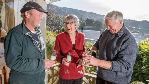 Joseph Sullivan's rowing coach Dave Bugler, left, with Joseph's parents Mike and Elaine Sullivan toast to the America's ...