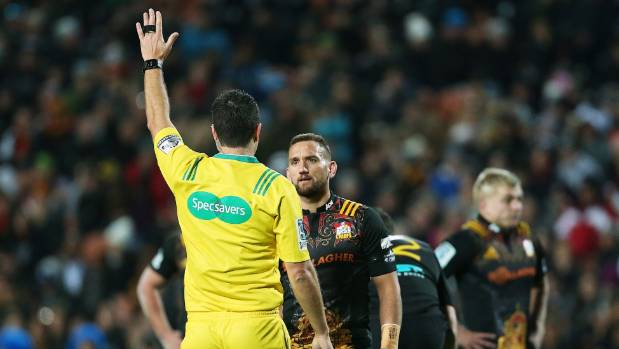 Schoolboy Jack Riley believes professional referees are being booed too much. Pictured: Referee Ben O'Keefe discussing a ...