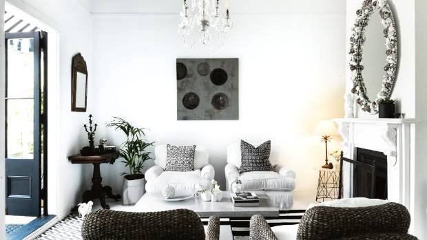The living room in Jo Nicholls' Newmarket, Auckland home is filled with items dear to her heart; the shell mirror above ...