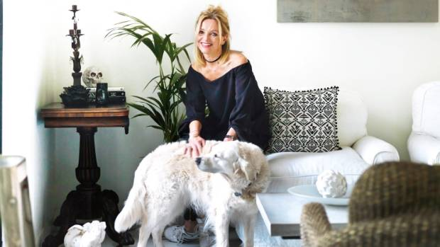 Jo Nicholls says golden retriever Tully fits perfectly with the decor.
