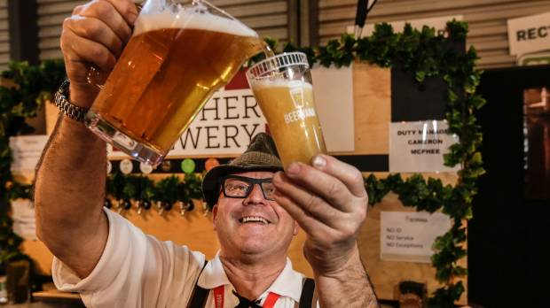 Dicky Fife, brewing captain for Kaiser Brothers Brewery serves up a KB pilsner at the first day of Beervana.