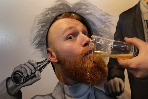 Chris Miller partakes of a white IPA at the Tinker Tailor stall at Beervana on Friday.