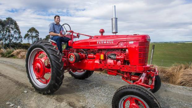 Nigel Gamble on his family's 1947 Farmall H tractor he restored.