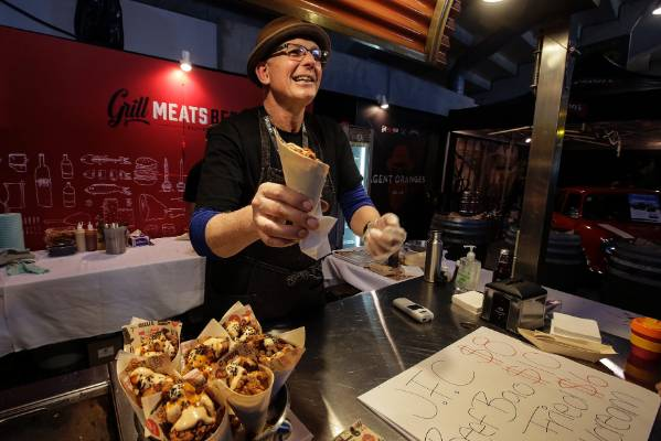 Steve Logan of Grill Meats Beer serves up Japanese fried chicken.