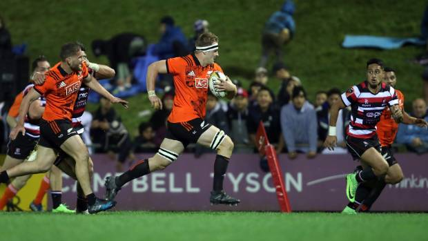 Sam Cane strides out on his way to a try against Counties.