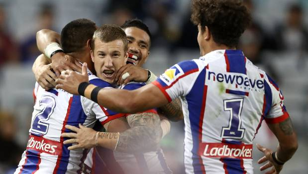 Ken Sio (left) celebrates with his Knights teammates Trent Hodkinson, Peter Mata'utia and Dane Gagai after one of his ...