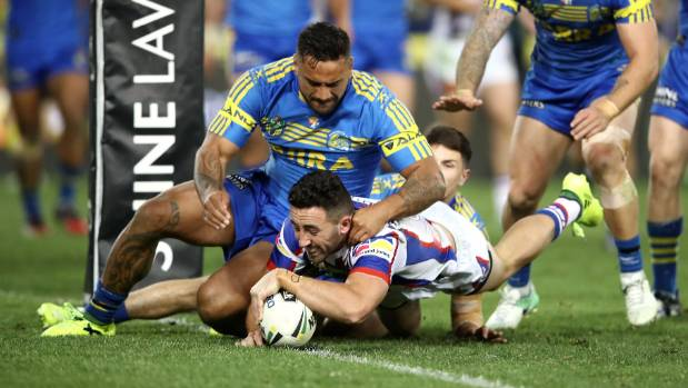 Newcastle's Brock Lamb dives over to score in the Knights' convincing win over the Parramatta Eels.
