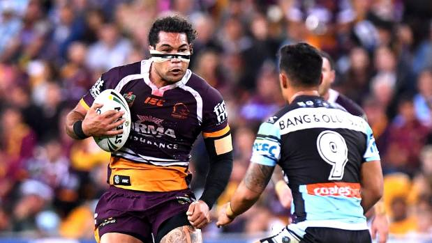 A bandaged Kiwis international Adam Blair charges at the Cronulla Sharks defence at Suncorp Stadium.