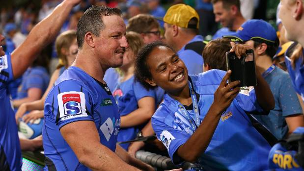 Heath Tessmann of the Force poses for a selfie with a supporter after winning the round two Super Rugby match against ...