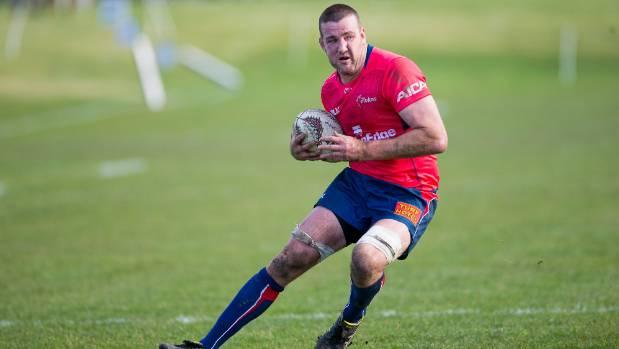Tasman lock Alex Ainley takes the ball into contact.
