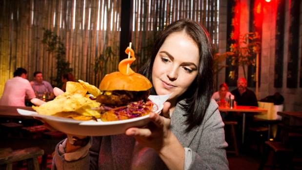 Miri Schroeter eyes up Dragonfly's chicken burger. Number nine in her failed attempt to eat 123 burgers.