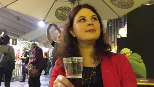 Journalist Katie Chapman contemplates the level of hops in a beer.