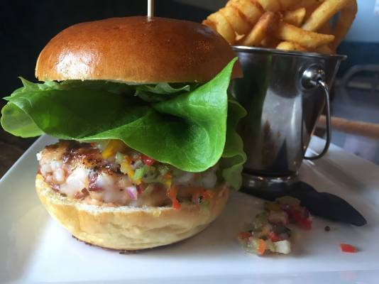 Crayfish and chorizo patty, kiwifruit salsa, and bloody mary sauce in a brioche bun, from Counter Culture, Wellington.
