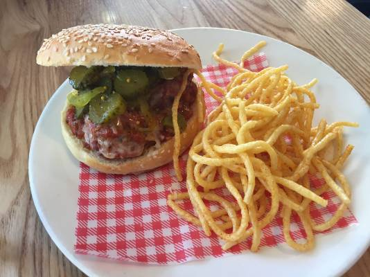 Pork and herb meatballs braised in tomato with a pickle and provolone cheese. Served with tomato salt spaghetti fries, ...