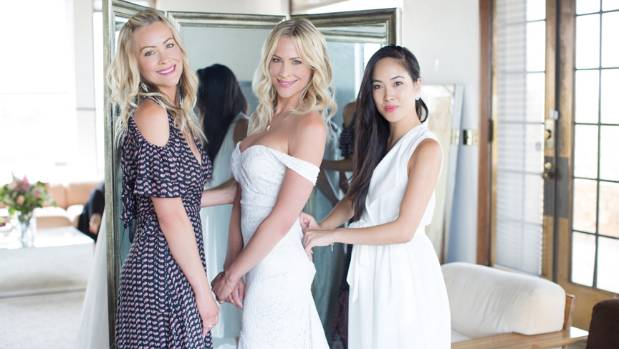 Bride Brittany Daniel with her twin sister Cynthia Daniel Hauser with Trish Peng.