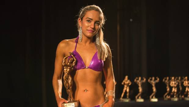 Jessyka Melo with her trophy after competing in the WFF Class Ms Bikini Top of the South Body Building Classic held at ...
