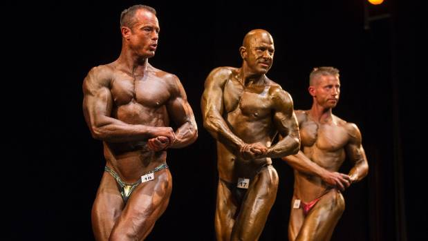 Ben Smith, left, James Higgs, and Robin Vis flex during the WFF Class 9 Mens Performance and Mens Super Body Top of the ...