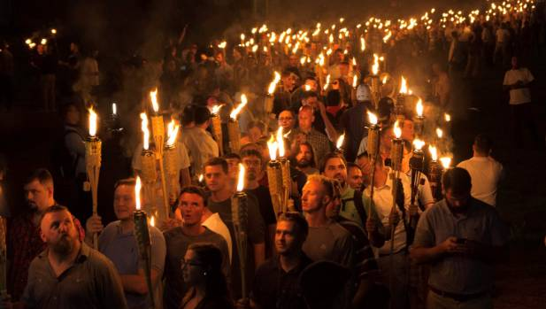 White nationalists carry torches on the grounds of the University of Virginia, on the eve of a planned Unite The Right ...