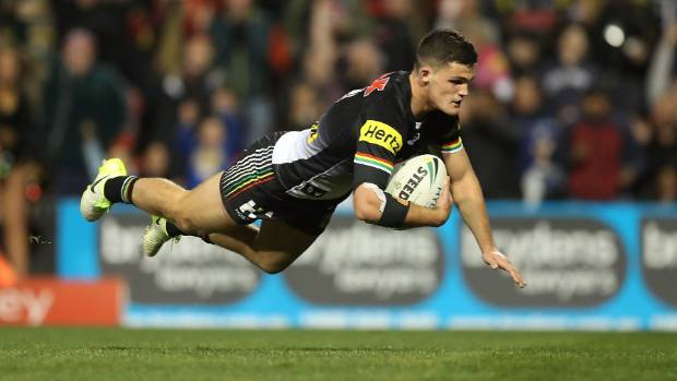 Nathan Cleary of the Panthers dives over to score one of his two tries in Penrith's win over North Queensland.